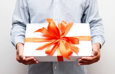 Gift box in hand.
