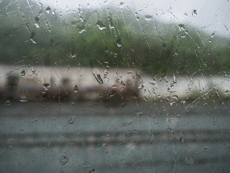 Blur of Abstract Rainfall on The Mirror Image Trainの写真素材