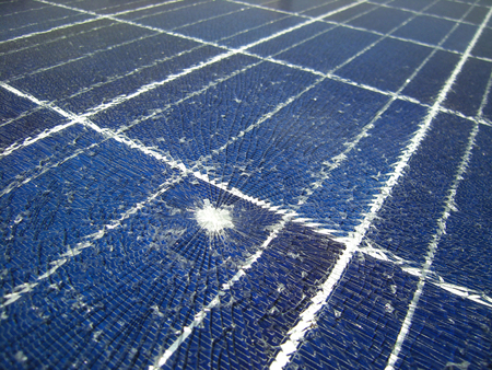 Photo for Solar Panels Broken by Falling Bullet - Royalty Free Image