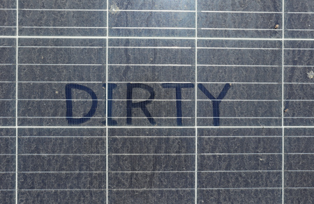 Photo for Dirty Dusty Solar Panels with Text DIRTY top view - Royalty Free Image