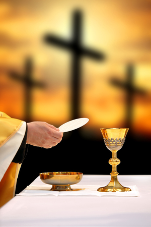 Photo pour Holy communion on the background of three crosses on top of Golgotha. Easter holiday concept with empty space for text. - image libre de droit
