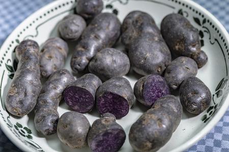 Truffle potato, Vitelotte, Blue-violet potatoes in a nostalgic bowl