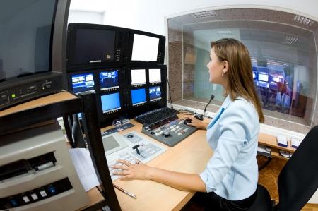 female TV director at editor in studio