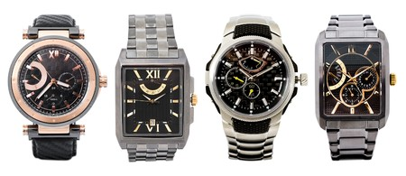 a set of four different mens watches over white