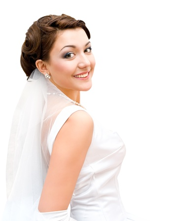 young charming bride looks into camera, isolated