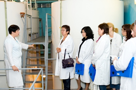 ULAN-UDE, RUSSIA - AUGUST 18: The main technologist of Baikalfarm, the biggest regional distillery, introduces manufacturing process to journalists, August 18, 2010, Ulan-Ude, Buryatia, Russia.