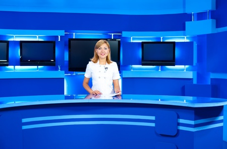 a television announcer at studio during live broadcasting