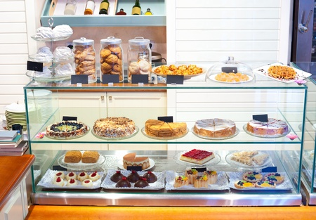 at a confectioners shop - a glass showcase with desserts