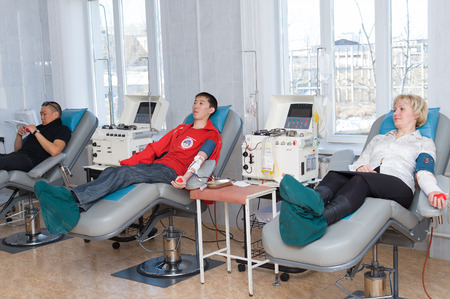 ULAN-UDE, RUSSIA - APRIL 6, 2010: Unidentified volunteers donate blood at the City Blood Service which makes a promo action for donorship popularization.