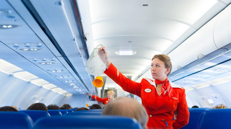 Photo pour MOSCOW - MAY 28, 2011: Air hostess Yulia of Aeroflot shows how to use an oxygen mask on board. Aeroflot operates the youngest fleet in the world among major airlines, numbering 150 airliners. - image libre de droit