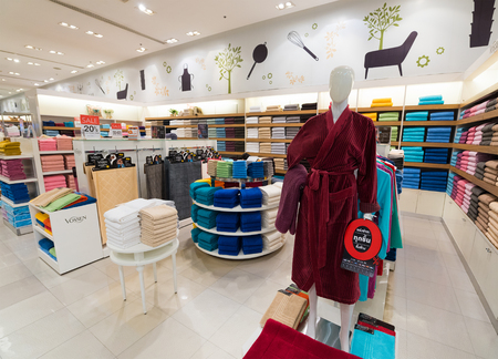 BANGKOK - MARCH 17, 2016: Various towels and bathrobes at a store of home goods in the Siam Paragon Mall. It is one of the biggest shopping centres in Asia.
