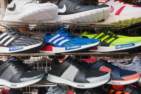KUALA LUMPUR - MARCH 14, 2017: Counterfeit sports shoes for sale at the Chinatown market known as Petaling Street. It is famous with its budget hotels and food.