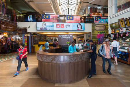 KUALA LUMPUR - SEPT 12, 2017: People walk in the lobby of Central Market. It was founded in 1888 and originally used as a wet market while the current Art Deco style building was completed in 1937