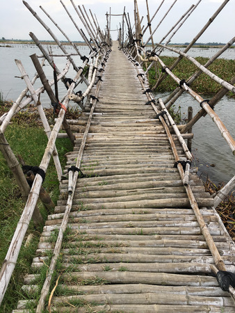 bamboo pedestrian bridge on a cloudy day in tropics