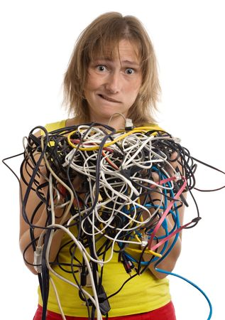 crazy woman with tangle of cables and wires in hands isolated on white