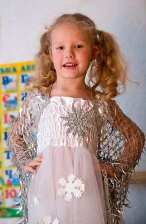 Small girl in holiday carnival  snowflake costume