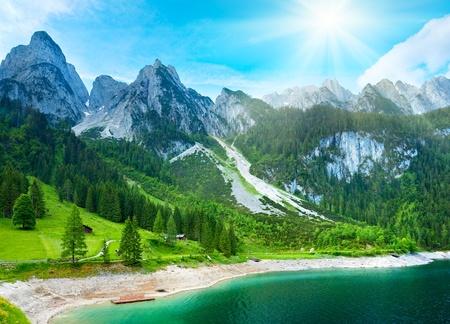 Beautiful summer Alpine mountain  lake view and sunshine in sky
