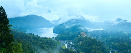 Cloudburst above historic medieval Neuschwanstein Castle in Bavaria (Germany). View from Neuschwanstein Palace.  Five shots composite picture.