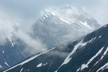 Summer cloudy mountain landscape (Oberalp Pass, Switzerland)