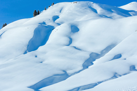 Winter mountain slope with snowdrift covered (Austria).