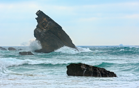 Atlantic ocean coast view (granite boulders and sea cliffs) in cloudy weather near  Cape Roca (Cabo da Roca), Portugal.