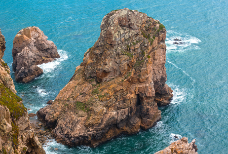 Boulders near shore. Atlantic ocean coast. View from Cape Roca (Cabo da Roca), Portugal.