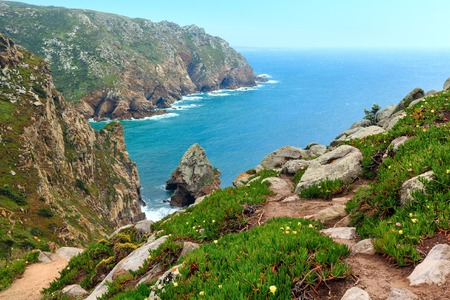 Atlantic ocean coast in cloudy weather. View from Cape Roca (Cabo da Roca), Portugal.