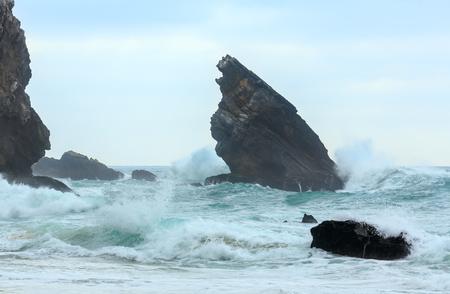 Atlantic ocean coast view (granite boulders and sea cliffs) in cloudy stormy weather near Cape Roca (Cabo da Roca), Portugal.