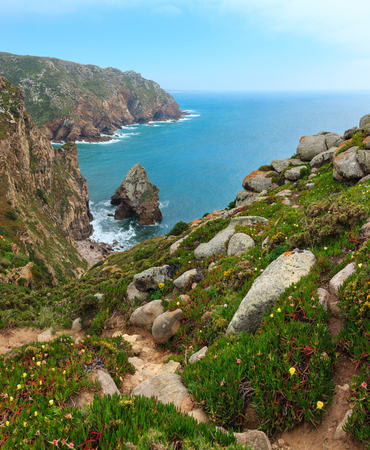 Atlantic ocean coast in cloudy weather. View from blossoming Cape Roca (Cabo da Roca), Portugal. Two shots stitch image.