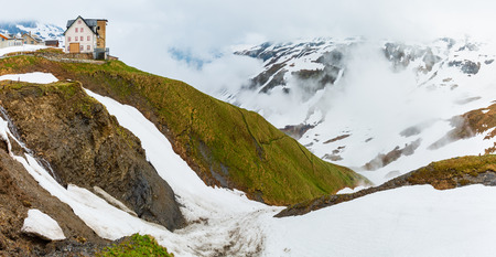 Spring cloudy overcast mountain panorama landscape on Furka Pass, Switzerland.