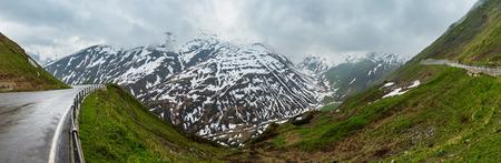 Spring cloudy overcast mountain landscape (Oberalp Pass, Switzerland)