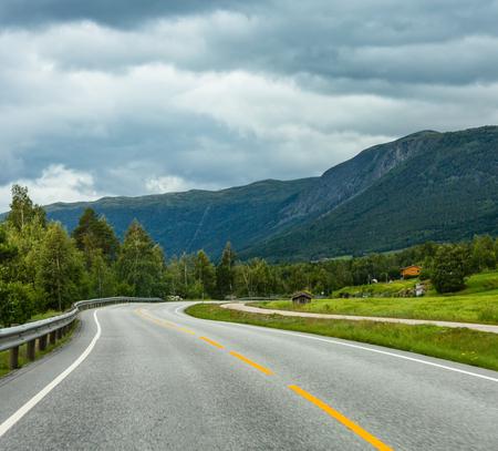 Photo pour Summer cloudy mountain landscape with serpentine secondary road, Norway - image libre de droit