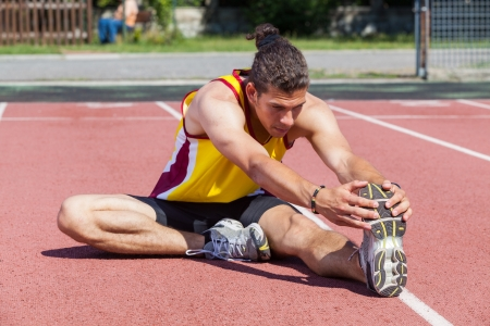 Track and Field Athlete Stretching