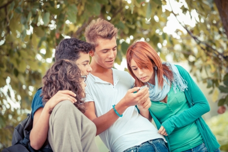 Photo for Group of Teenage Friends with Mobile Phone - Royalty Free Image