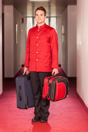 Photo pour Bellboy with Luggages in the Hallway - image libre de droit