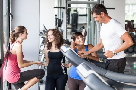 Attractive Man at Gym with Three Womenの写真素材