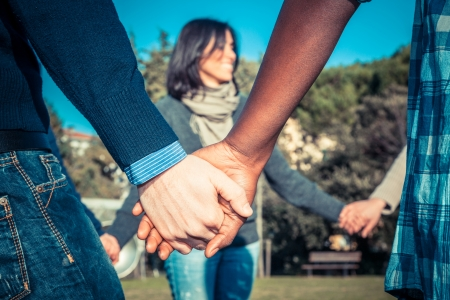 Foto de Multiracial Young People Holding Hands in a Circle - Imagen libre de derechos