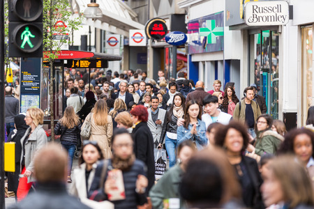 LONDON, UNITED KINGDOM - APRIL 17, 2015: Crowded sidewalk on Oxford Street with commuters and tourists from all over the world.