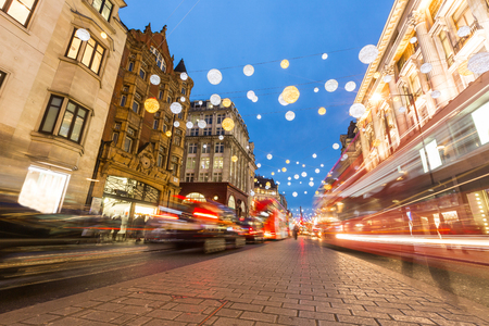 Oxford street in London with Christmas lights and blurred traffic. It is one of the busiest street of the capital city of England, and during Christmas time it becomes magic and fairy.