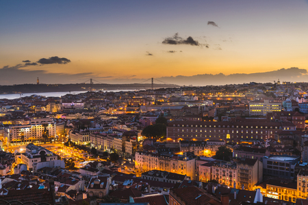 Foto de Lisbon panoramic view at dusk. Beautiful and colourful warm view of the capital city of Portugal with lights turned on. Travel and architecture concepts - Imagen libre de derechos