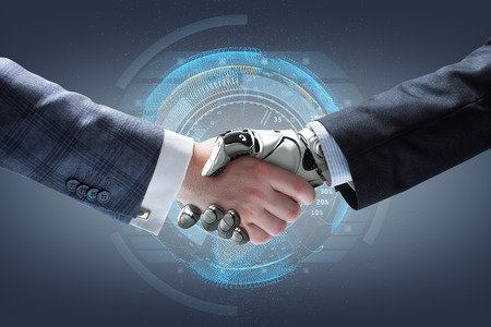 Photo pour Businessman and robot's handshake with holographic Earth globe on background. Artificial intelligence technology - image libre de droit
