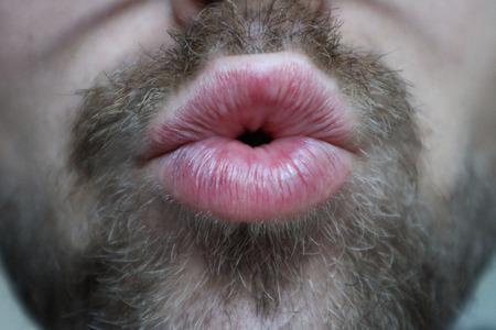 Man with facial hair giving kiss