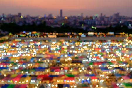 Blur of famous night market at twilight. Ratchada Train Market : second hand night market, Bangkok, Thailand.
