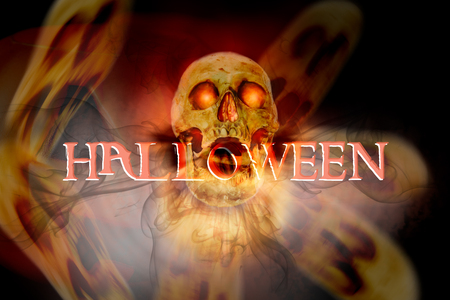 View of skull and wording HALLOWEEN on dark background.