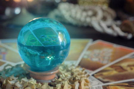 View of crystal ball on the table. Soft focus.