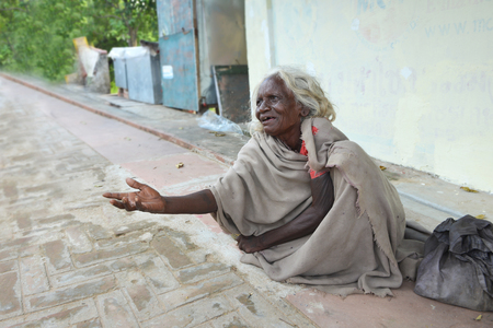 Photo for GAYA,BIHAR, INDIA-October 16 2019: An Indian woman begging on the streets - Royalty Free Image