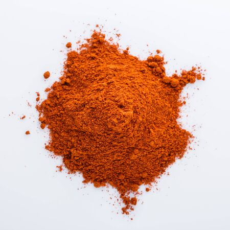 Photo for aromatic spicy chili powder on a white background. - Royalty Free Image