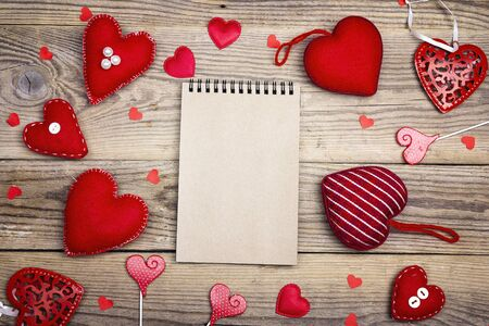 Photo pour Open blank notebook with Valentine hearts on old wooden background. Copy space. Valentines day background. Top view. - image libre de droit