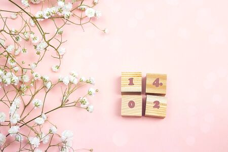 Photo pour Valentine's day background with floral border and date. Place for text. Flat lay, top view. - image libre de droit