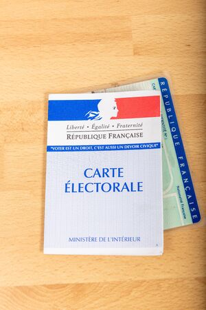 Photo pour France, Paris, November, 14, 2019, French electoral voter cards official government allowing to vote paper on wooden background, France - image libre de droit